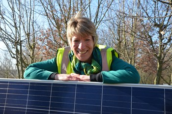 Councillor Pippa Heylings behind the solar panels at our Waterbeach depot