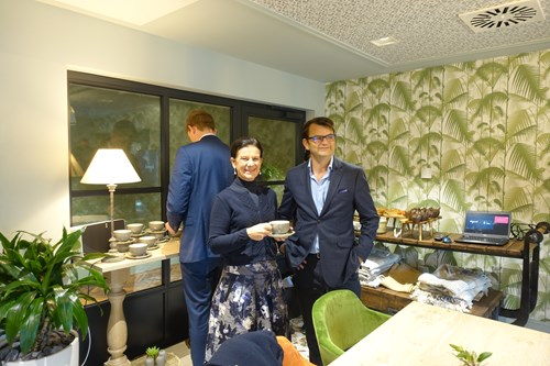 Cllr Bridget Smith drinking a cup of tea with Inspired Villages Chief Finance Officer, Tom Ford