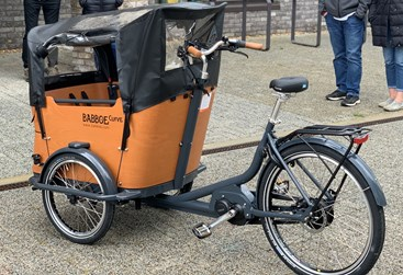 A tricycle with a cargo area on top