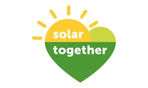 The logo for the solar together scheme. It is heart shaped. The bottom of the heart is green. The top of the heart is yellow and has rays of sunshine emanating from it.