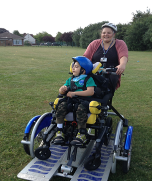 Trying out a specially adapted bike for wheelchair users at Castle School